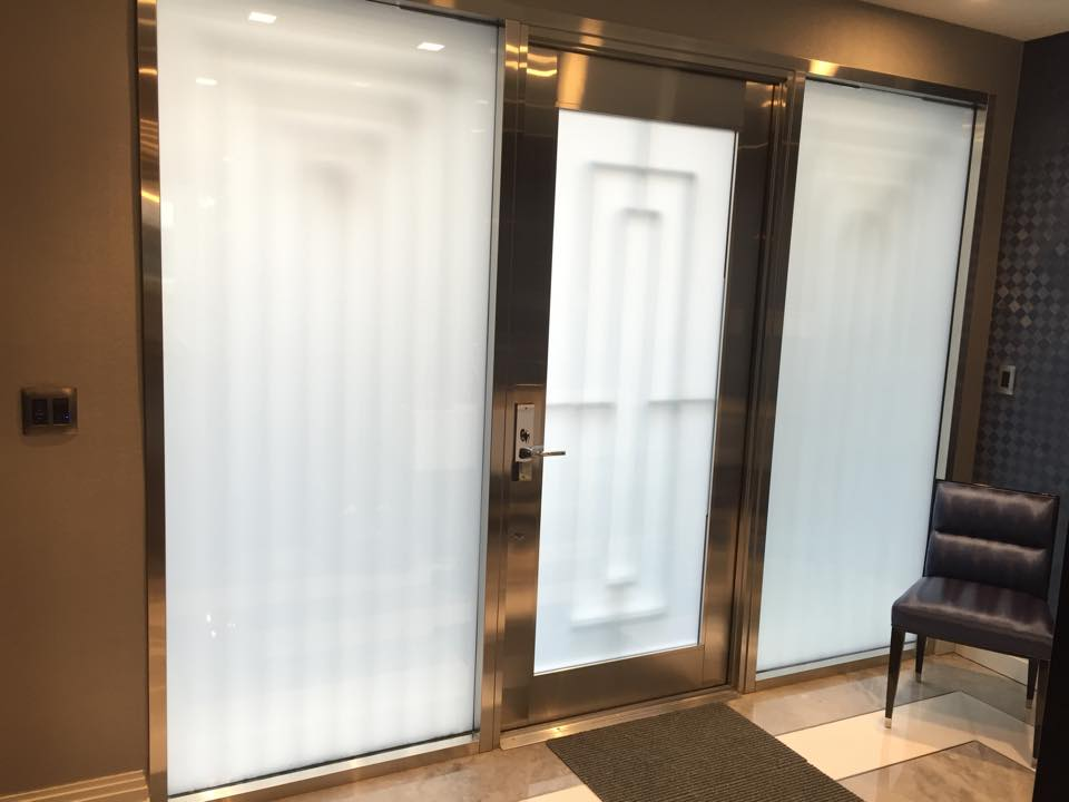 On demand privacy with automated front entry glazed glass.